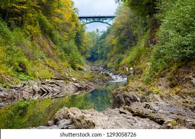 Quechee Gorge Vermont bridge river rocks and foliage