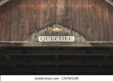 Quechee, VT 07/1/20: A Covered Wooden Bridge Over A Waterfall / Lake. The Entrance To Quechee Vermont / VT