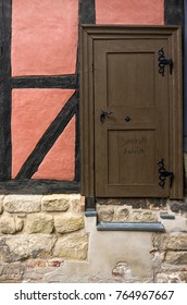 QUEDLINBURG, GERMANY – August 16, 2017: SMASH ANTIFA graffito on a wooden door of a half-timbered house in Quedlinburg, Saxony-Anhalt, Germany.
