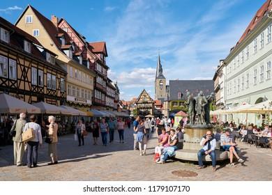 QUEDLINBURG, GERMANY – SEPTEMBER 08, 2018: Tourists on the market square of the medieval old town of Quedlinburg