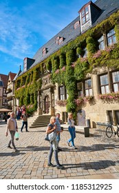 QUEDLINBURG, GERMANY – SEPTEMBER 08, 2018: Tourists in front of the historic town hall of the medieval old town of Quedlinburg in Germany