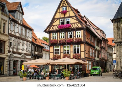 Quedlinburg, Saxony Anhalt, Germany- Sep 30, 2018-Fachwerk facade of old historic town. Old house with flowers,
