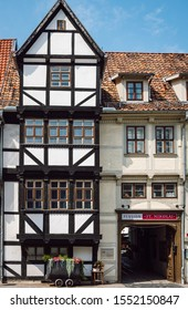 Quedlinburg/Germany-Aug 2, 2019 View of a framework white house and in front of it an old mining cart now used as a flower pot, pension St. Nikolai, old medieval town of Quedlinburg, Saxony-Anhalt.