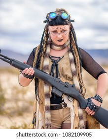 The queen of the apocalypse. A female militia soldier in a post apocalyptic desert wasteland. Urban combat and wasteland inspired.