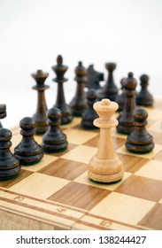 Queen is checking the king. chess pieces on a chess board on a white background