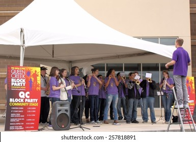QUEEN CREEK, ARIZONA/USA - FEBRUARY 28: Unnamed members of the Queen Creek High School SPILLED band perform on February 28, 2015 at the newly reopened Town Center in Queen Creek, Arizona.