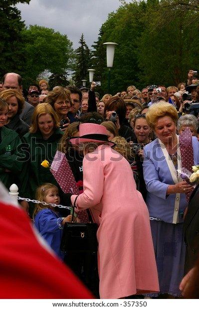 Queen Elizabeth II accepts flowers from a small child during the Royal Visit to Edmonton, Alberta, Canada, May 24, 2005.