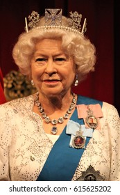 Queen Elizabeth, London, United Kingdom - March 20, 2017: Queen Elizabeth ii 2 portrait wax figure at museum waring crown George IV State Diadem, London