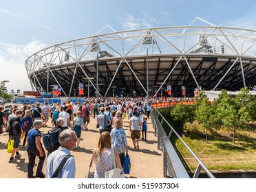 Queen Elizabeth Olympic Park, London - July 27, 2013: Crowds stream into the Queen Elizabeth Olympic Park for the Anniversary Games