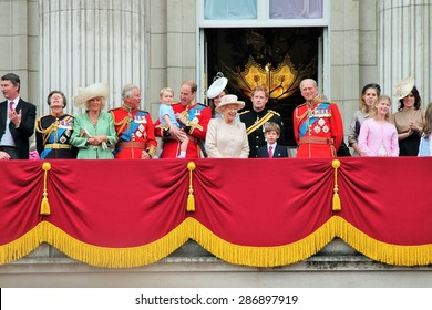 Queen Elizabeth & Prince Philip, BUCKINGHAM PALACE LONDON UK - JUNE 13 2015: balcony Trooping the Colour Prince William Prince Harry Charles Prince Georges 1st time on balcony: stock photo image press