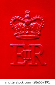 The Queen Elizabeth Royal Crest on a red Post Box in the United Kingdom.