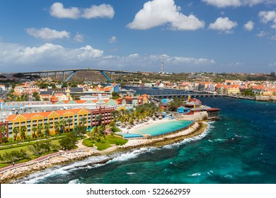 The Queen Emma Bridge is a pontoon bridge across St. Anna Bay in Curacao. It connects the Punda and Otrobanda quarters of the capital city, Willemstad.