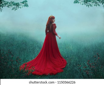The Queen in a luxurious, expensive, red dress, walks in a thick fog with a long train. A young-haired girl in a golden crown examines her possessions. The background is cold, misty autumn. Art photo.