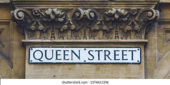Queen Street Name Sign below Corinthian Column, Shallow Depth of Field horizontal photography