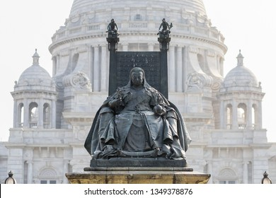 Queen Victoria Monument with Victoria Memorial's central dome in the background. Kolkata, India.