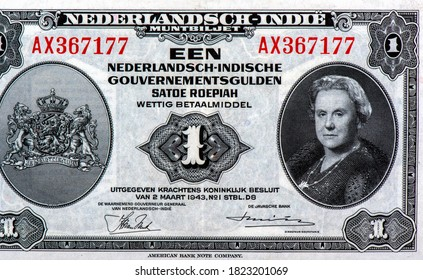 "Queen Wilhelmina. Lions and a crown with inscription: ""Je Maintiendrai"". Portrait from Netherlands Indies 1 Gulden Roepiah 1943 Banknotes."