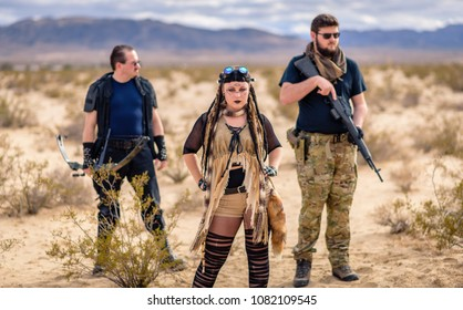 Queens of the Apocalypse. A female militia leader and her two flanking soldiers. Post apocalyptic themed and shot in the California desert