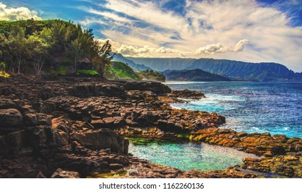 Queens Bath in Princeville on the hawaiian island of Kauai is a beautiful natural tidepool nestled among black volcanic cliffs that is perfect for a photogenic swim in paradise.
