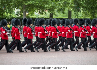 Queen's foot guards marching in formation down The Mall in a royal Trooping the Colour ceremony in London England