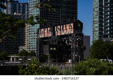 Queens, New York, July, 2018: a Gantry of Gantry plaza state park with buildings