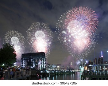 QUEENS, NEW YORK - JULY 4: Macy's independence day firework celebration in NYC as viewed from Gantry Plaza State Park in Long Island City.   Taken July 4, 2015 in Queens, NY.