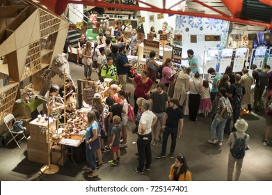 QUEENS, NEW YORK - SEPTEMBER 23, 2017: Vendors and attendees on the floor of the New York Hall of Science at the World Maker Faire where makers displayed their creations, tools, and DIY projects.