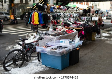 Queens, New York USA - February 11 2021: Sidewalk Vender Selling Masks and Winter Accessories during the Covid 19 Pandemic in Astoria Queens of New York City
