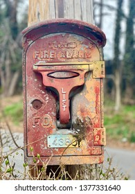 Queens, NY - 5 April, 2019: An old red fire call box in NYC. They were used to notify the fire department of a fire.