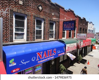 Queens, NY - July 20 2012: Storefronts along Liberty Avenue in Ozone Park