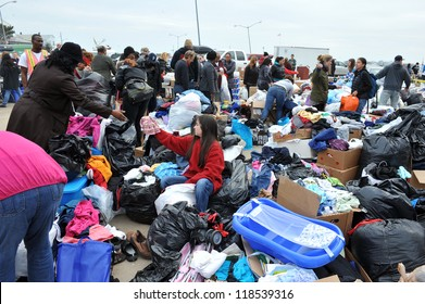 QUEENS, NY - NOVEMBER 11: People getting help with hot food, clothes and supplies in the Rockaway due to impact from Hurricane Sandy in Queens, New York, U.S., on November 11, 2012.