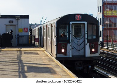 QUEENS, NY / USA - January 20, 2018: 7 train arriving to station.