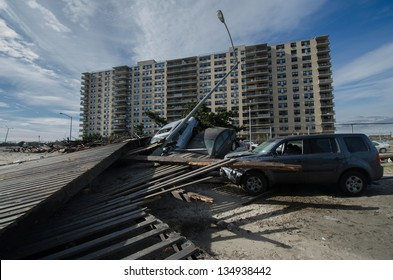 QUEENS, NY/USA - NOVEMBER 1: Cars stacked by the destroyed boardwalk in the aftermath of hurricane Sandy on November 1, 2012 in the Rockaway section of Queens.