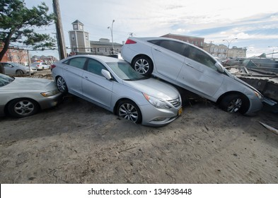 QUEENS, NY/USA - NOVEMBER 1: Cars stacked in the aftermath of hurricane Sandy on November 1, 2012 in the Rockaway section of Queens.