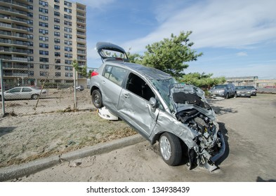 QUEENS, NY/USA - NOVEMBER 1: A destroyed car in the aftermath of hurricane Sandy on November 1, 2012 in the Rockaway section of Queens.