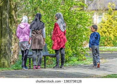 Queens Park Blackburn, Lancashire/England - 29.04.2019 - Group of young Asian children playing in the park