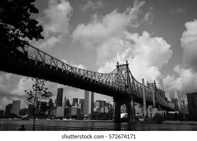 Queensboro bridge over the river and buildings in black and white style, New York