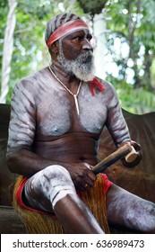 QUEENSLAND, AUS - APR 17 2016: Yirrganydji Aboriginal Australians man play Aboriginal music with Clapstick, percussion musical Instrument made out of wood in Queensland, Australia.