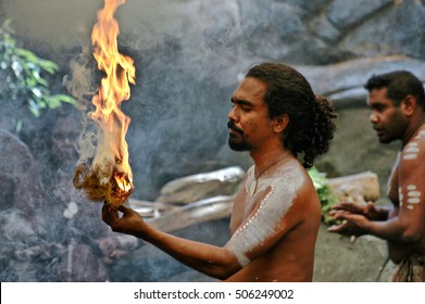Queensland, Australia. Circa May 2005. Australian native performing traditional ritual with fire.