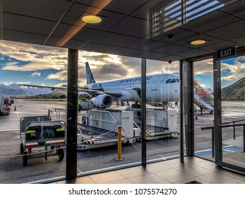 QUEENSTOWN, NEW ZEALAND - 17 APRIL 2018: Air New Zealand flight at arrival gate in Queenstown airport.