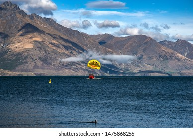 QUEENSTOWN ,NEW ZEALAND - April 11,2019 : Parasail flight, one of the most popular world famous iconic scenery of Remarkable mountain of New Zealand