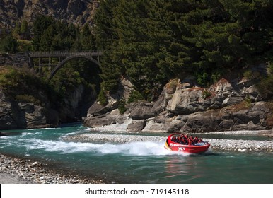 QUEENSTOWN, NEW ZEALAND - August 28: Tourists enjoy a high speed jet boat ride on the Shotover River on August 28, 2017 in Queenstown, New Zealand. Queenstown is a popular summer resort.