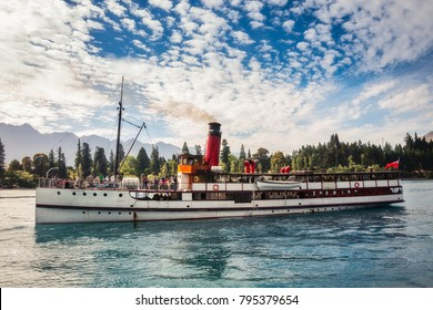 Queenstown, New Zealand -December 23, 2017: Morning Cruise on board of Queenstowns iconic vintage steamship TSS Earnshow, one of the turistic attractions on Lake Wakatipu, Otago Region.