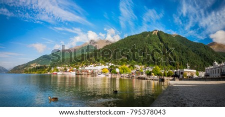 Queenstown, New Zealand -December 23, 2017: View of the alpine city of Queenstown in New Zealand, from the marina bay of Lake Wakatipu with the iconic Queenstown Skyline mountain in the background.