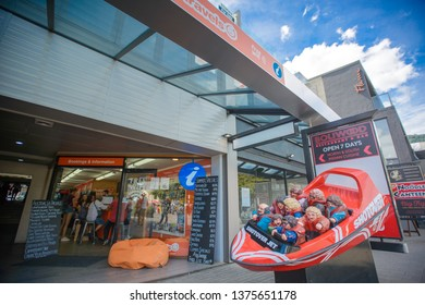 Queenstown , New Zealand, Feb 8th, 2019: Queenstown city view with travel jetboat agency Shotover