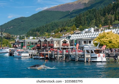 Queenstown, New Zealand - January 19th 2018: A semi-submersible Seabreacher X watercraft painted like a shark cruises away from the dock as it heads out for a thrill ride across Lake Wakatipu
