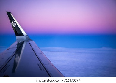 QUEENSTOWN NEW ZEALAND - JULY 12, 2017: View of Air New Zealand wing and Koru emblem during a flight from Auckland to Queenstown.  The airline launched after dark flights to the ski resort in 2015.