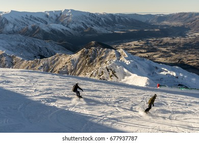 QUEENSTOWN, NEW ZEALAND - JULY 15: Unidentified skiers and snowboarders enjoying early season snow and great views on Coronet Peak ski field on July 15, 2017 in Queenstown, South Island, New Zealand