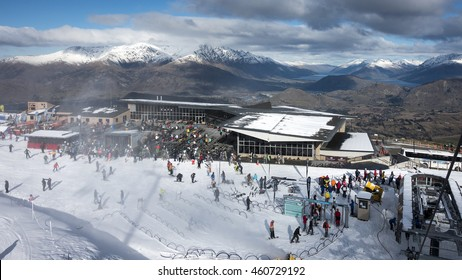 QUEENSTOWN, NEW ZEALAND - JULY 26: Unidentified skiers and snowboarders enjoying early season snow and great views on Coronet Peak ski field on July 26 2016 in Queenstown, South Island, New Zealand.