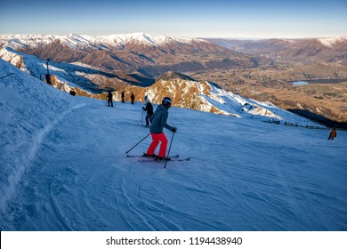 QUEENSTOWN, NEW ZEALAND - JULY 8, 2018: Skiers and snowboarders enjoy winter snow at Coronet Peak in Queenstown.  This alpine resort town is one of the most popular visitor destinations in New Zealand