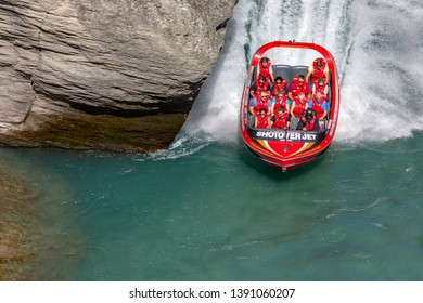 QUEENSTOWN, NEW ZEALAND - MARCH 03, 2019: Tourists enjoy a high-speed boat ride on Shotover river near Queenstown. Queenstown is a recognized center of extreme entertainment. South Island